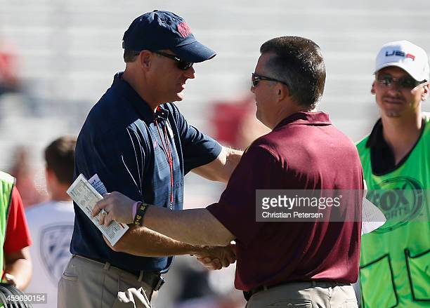 Head coaches Rich Rodriguez of the Arizona Wildcats and Todd Graham of the Arizona State Sun Devils shake hands prior to the Territorial Cup college...
