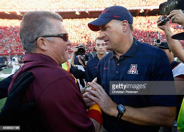 Head coaches Rich Rodriguez of the Arizona Wildcats and Todd Graham of the Arizona State Sun Devils shake hands after the Wildcats defeated the Sun...