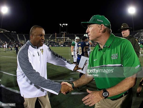 Head coaches Ron Cooper of the FIU Panthers and Doc Holliday of the Marshall Thundering Herd shake hands after the game on November 19 2016 in Miami...