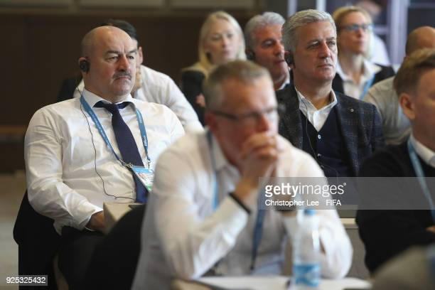 Head Coaches Stanislav Cherchesov of Russia with Vladimir Petkovic of Switzerland listen in during the Technical Workshop during Day 2 of the 2018...