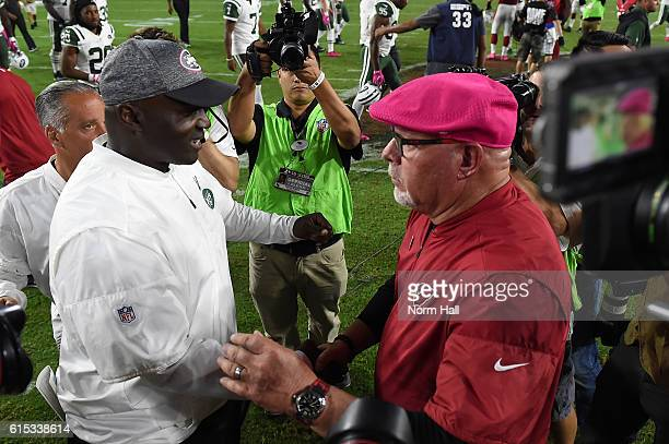 Head coaches Todd Bowles of the New York Jets and Bruce Arians of the Arizona Cardinals shakes hands after the NFL game at University of Phoenix...