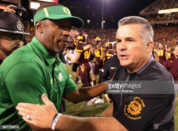 Head coaches Willie Taggart of the Oregon Ducks and Todd Graham of the Arizona State Sun Devils shake hands following the college football game at...