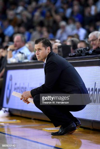 Head coachh David Joerger of the Sacramento Kings looks on against the Golden State Warriors during their NBA basketball game at ORACLE Arena on...
