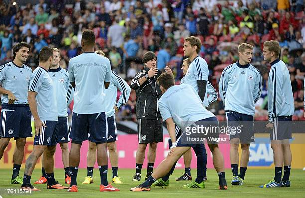 Head coah Joachim Loew talks to the team during the German National Football Team trainings session at Coface Arena on August 12 2013 in Mainz...