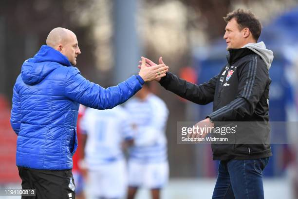 Head coah Torsten Lieberknecht of MSV Duisburg and head coach Claus Schromm of Unterhaching shake hands after the 3. Liga match between SpVgg...