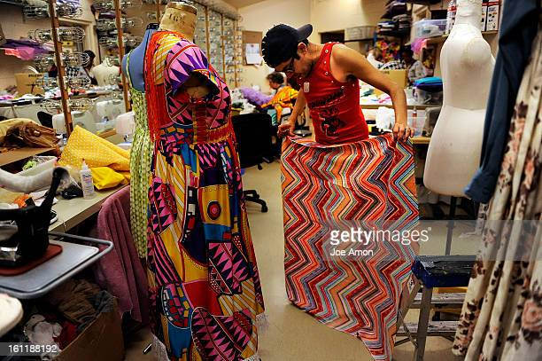 Head costumer Designer Mondo Guerra deciding on cloth for handkerchief sleeves for one of the costumes for the Arvada Center's production of...