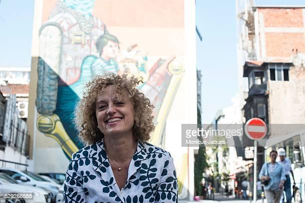 Head curator of the 2015 Istanbul Biennale Carolyn ChristovBakargiev in front of a street art mural in Kadikoy Istanbul on Wednesday September 10...