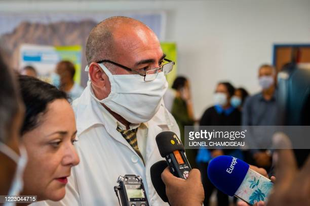 Head doctor Abel Roberto Fuentes Santiesteban speaks to the press after arriving with a delegation of Cuban doctors at the Martinique-Aime-Cesaire...