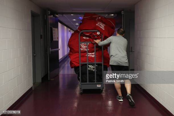 Head Equipment Manager Paul Boyer of the Detroit Red Wings rolls equipment bags down the hall after the Detroit Red Wings against the Washington...