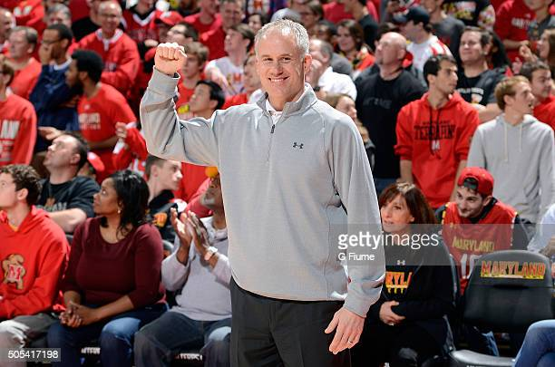 Head football coach DJ Durkin waves to the crowd during the game between the Maryland Terrapins and the Ohio State Buckeyes at Xfinity Center on...