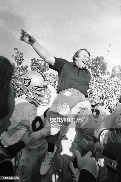 Head football coach John Madden is carried on the shoulders of the Oakland Raiders Football Team after winning their first Super Bowl. The Raiders...