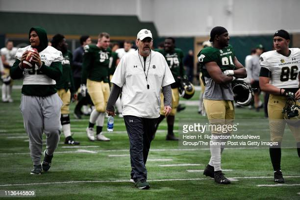 CSU head football coach Mike Bobo center prepares his players before the start of the team's 2019 Rams football spring game at the team's indoor...