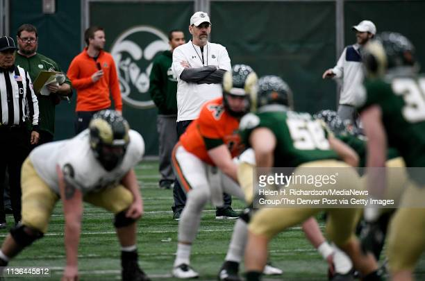CSU head football coach Mike Bobo center watches his players during the team's 2019 Rams football spring game at the team's indoor practice facility...