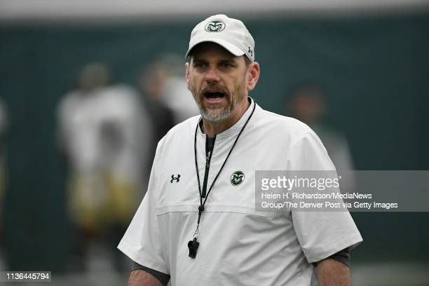 CSU head football coach Mike Bobo center yells to his players on the field during the team's 2019 Rams football spring game at the team's indoor...