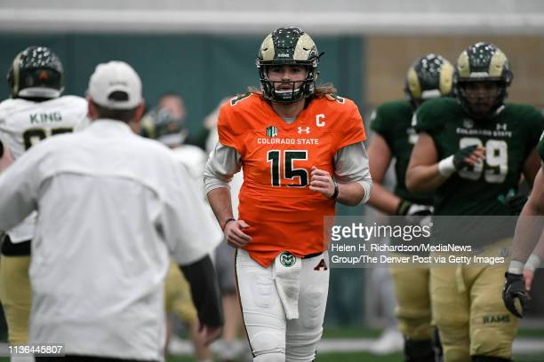 CSU head football coach Mike Bobo left talks to CSU quarterback Collin Hill #15 as he comes off the field during the team's 2019 Rams football spring...