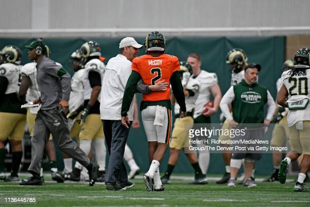 CSU head football coach Mike Bobo left talks with CSU Rams quarterback Justice McCoy right as they walk off the field during the team's 2019 Rams...
