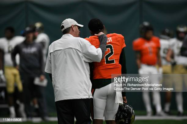 CSU head football coach Mike Bobo left talks with CSU Rams quarterback Justice McCoy right during the team's 2019 Rams football spring game at the...