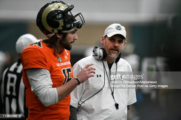 CSU head football coach Mike Bobo right talks with CSU Rams quarterback Collin Hill #15 during the team's 2019 Rams football spring game at the...