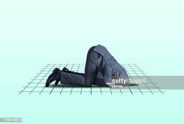 head in financial hole - distressed stock market people stock pictures, royalty-free photos & images
