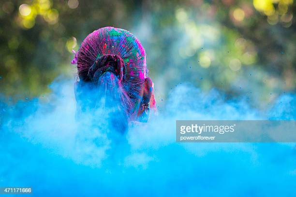 Head in Sea of Dye at Holi Festival