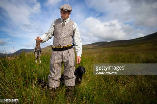 Head keeper Mark Palmer inspects one of the first grouse on the opening day of the grouse shooting season known as the 'Glorious Twelfth' on Rottle...
