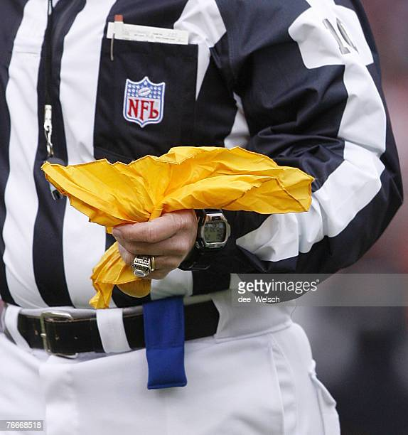 Head Linesman Ron Phares holding a yellow penalty flag at Invesco Field at Mile High Stadium Denver Colorado December 24 2006 Denver defeated...