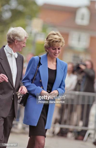Head Master of Eton College John Lewis with British Royal Diana, Princess of Wales , wearing a blue jacket over a black dress, outside Manor House on...
