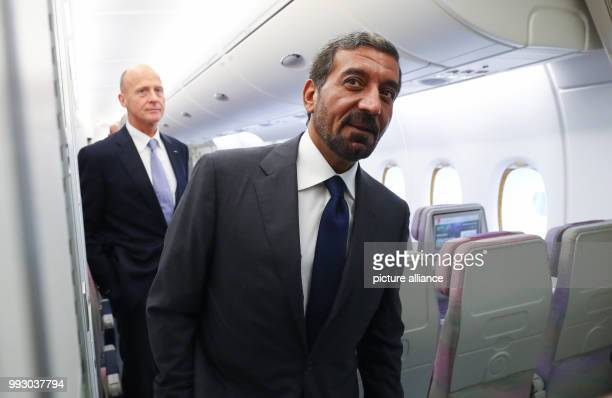 Head of Airbus Thomas Enders and the chairman of the Emirates Group sheik Ahmed bin Saeed Al Maktoum inspect a first class cabin inside an Airbus...