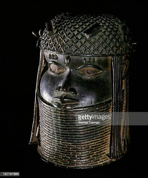 Head of an Oba from an ancestral shrine,The head has a high coral collar and a beaded cap with coral clusters. Nigeria. Benin. 17th century. Benin.