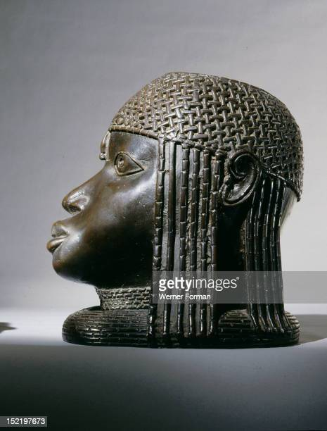 Head of an Oba from an ancestral shrine,The head has a low coral collar and a beaded cap. Nigeria. Edo. Benin.