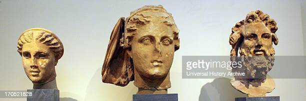 Head of Artemis The goddess wears a wreath The eyes were inlaid Head of Demeter Part of the himation that covered the goddess's head is preserved...