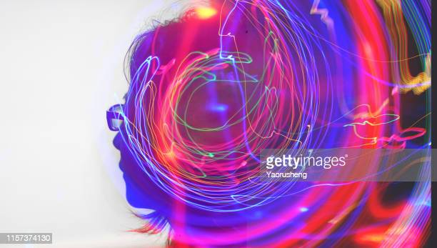 head of beautiful woman with double exposure of abstract lighting trails - sporting term stockfoto's en -beelden