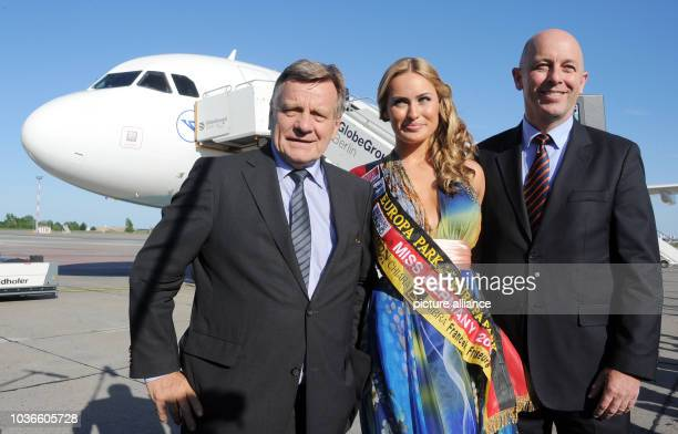 Head of Berlin's Willy Brandt airport Hartmut Mehdorn Miss Germany 2012 Anne Julia Hagen and the head of operations at Condor Uwe Balser stand in...