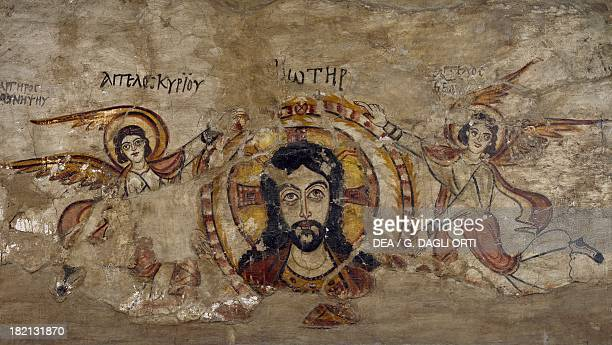 Head of Christ supported by two angels, wall painting, from the monastery of Deir al-Muharraq, Egypt. Coptic civilisation, 6th-7th century. Cairo,...
