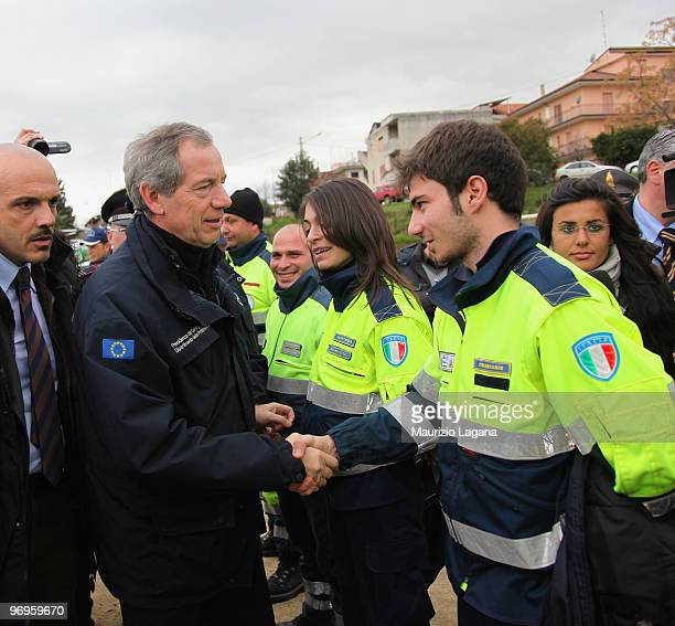 Head of civil protection Guido Bertolaso greets a man of civil protection during his visit in the town of Maierato on February 22 near Reggio...