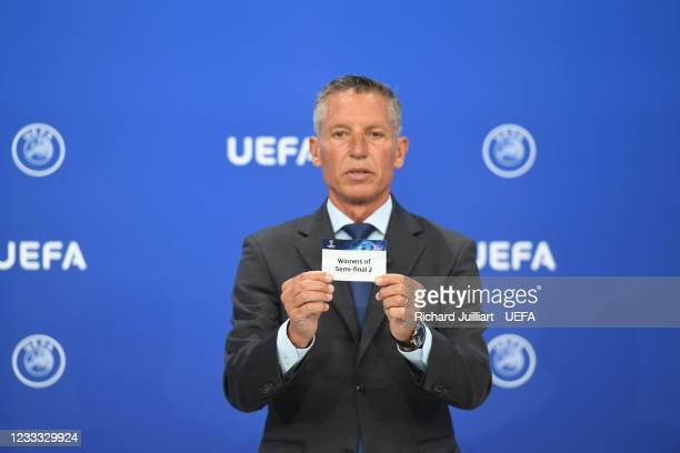 Head of Club Competitions Michael Heselschwerdt draws out the card of Winners of semi-final 2 during the UEFA Champions League 2021/22 Preliminary...