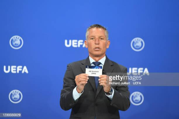 Head of Club Competitions Michael Heselschwerdt draws out the card of HB Tórshavn during the UEFA Champions League 2021/22 Preliminary Round draw at...