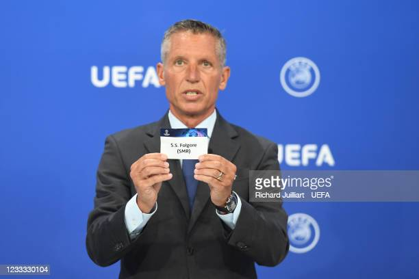 Head of Club Competitions Michael Heselschwerdt draws out the card of S.S. Folgore during the UEFA Champions League 2021/22 Preliminary Round draw at...