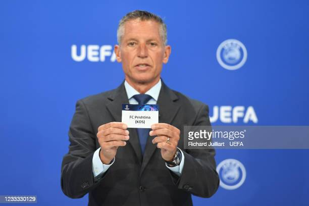 Head of Club Competitions Michael Heselschwerdt draws out the card of FC Prishtina during the UEFA Champions League 2021/22 Preliminary Round draw at...
