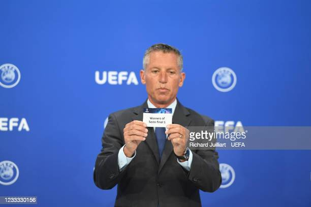 Head of Club Competitions Michael Heselschwerdt draws out the card of Winners of Semi-final 1 during the UEFA Champions League 2021/22 Preliminary...