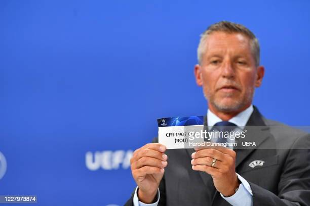 Head of Club Competitions Michael Heselschwerdt draws out the name of CFR 1907 Cluj during the UEFA Champions League 2020/21 First Qualifying Round...