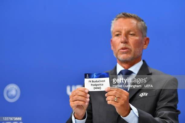 Head of Club Competitions Michael Heselschwerdt draws out the name of FK Buducnost Podgorica during the UEFA Champions League 2020/21 First...