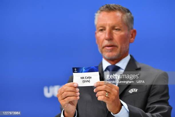 Head of Club Competitions Michael Heselschwerdt draws out the name of NK Celje during the UEFA Champions League 2020/21 First Qualifying Round draw...