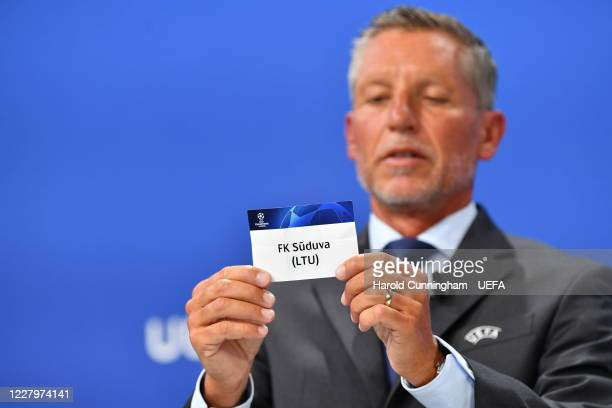 Head of Club Competitions Michael Heselschwerdt draws out the name of FK Suduva during the UEFA Champions League 2020/21 First Qualifying Round draw...