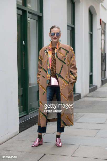 Head of Content at Tokyo Smoke Odessa Paloma Parker wears an Andrea Crews coat Philip Sparks blazer Vintage top Vicolo Jeans Coach bag Dorateymur...