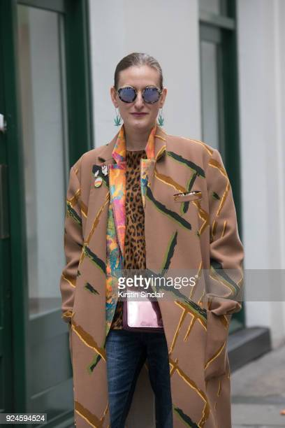 Head of Content at Tokyo Smoke Odessa Paloma Parker wears an Andrea Crews coat Philip Sparks blazer Vintage top Vicolo Jeans Coach bag and Miu Miu...