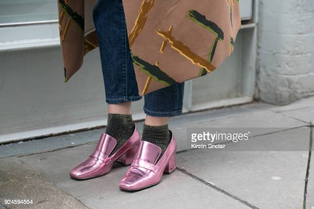 Head of Content at Tokyo Smoke Odessa Paloma Parker wears an Andrea Crews coat Dorateymur shoes on day 5 of London Womens Fashion Week Autumn/Winter...