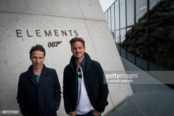 Head of Design art director and movie set designer Tino Schaedler and James Bond Art Director Neal Callow pose on July 11 2018 at the James Bond...