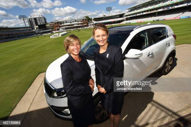 Head of England Women's Cricket Clare Connor and England Women's captain Charlotte Edwards pose with a Kia Sportage during a press conference to...