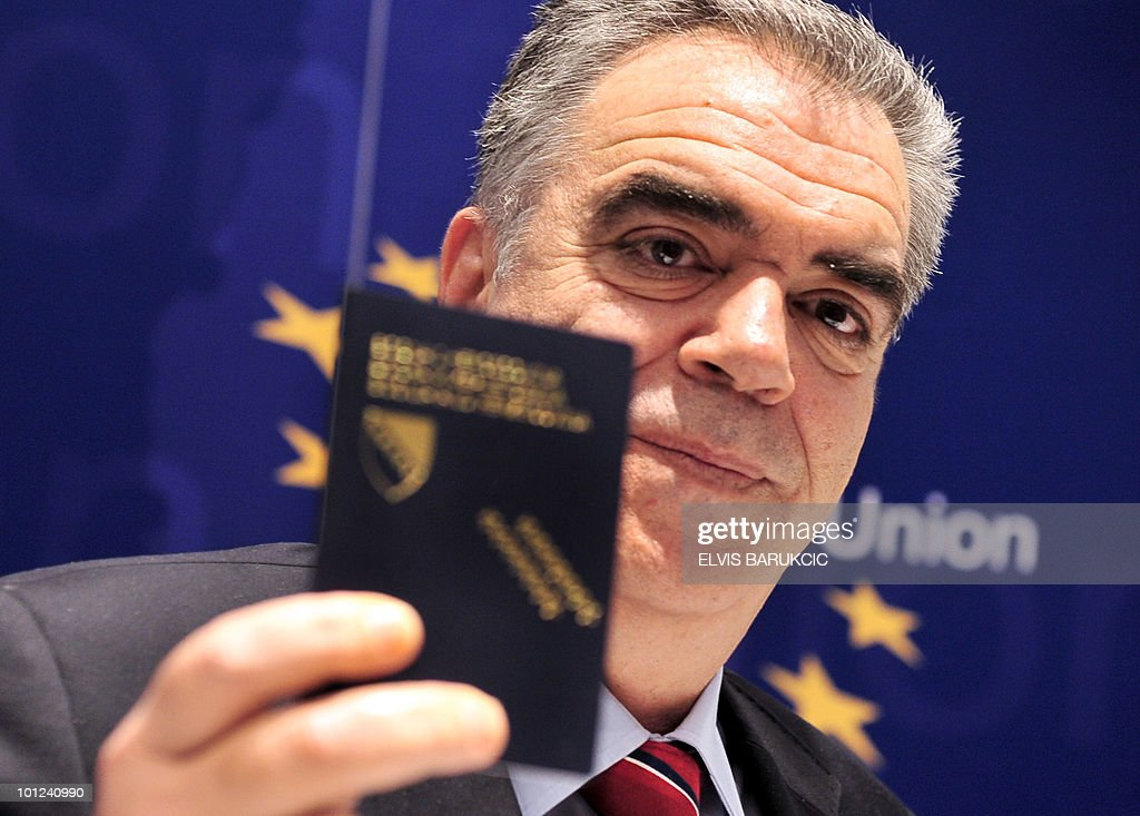 Head of EU mission to Bosnia and Herzegovina, Greek diplomat Dimitris Kourkoulas shows his Bosnian passport during a press conference in Sarajevo, on May 27, 2010, as he anounced the EU decision taken in Brussels to put Bosnia on the 'white list'. The European Commission formally recommended EU member countries and the European parliament to grant visa-free travel rights to Albania and Bosnia.